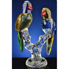 Gekleurde papegaaien op tak van kristal