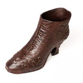 Gietijzeren plantenbak in vorm van laars schoen